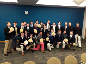 Fraternity men sporting the frisbees we gave them!